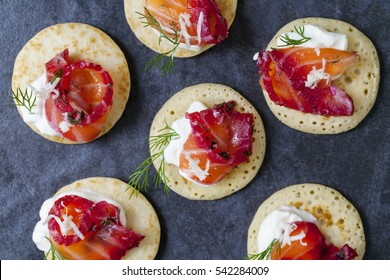 Party blinis with beetroot cured salmon, cream and horseradish
