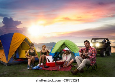 Party, Camping of asian man and women group, relaxing, sing a song and cooking, with ligh from car and tent