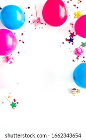 Party concept. Colorful balloons and confetti on white background top-down frame copy space