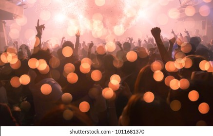 party concert abstract blur ,Crowd raising their hands and enjoying great festival party or concert. blur bokeh for background.