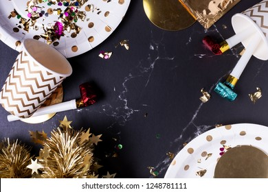party cup,party blower,tinsel,confetti.Holiday celebrate party time.top view tabletop.
