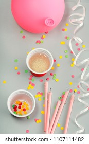 Party decoration with streamer, confetti, candles and pink balloon