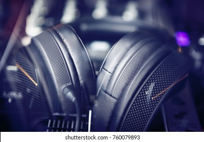 Party dj headphones in shop.Professional audio equipment for sale.Listen to thr music in high quality.Sound mixing equipment for disc jockey