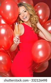 party, drinks, holidays, people and celebration concept - smiling woman in evening dress with glass of sparkling wine