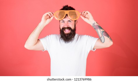 Party festive accessory. Sunglasses party attribute and stylish accessory. Party detail accessory concept. Man bearded hipster wears giant louvered sunglasses. Hipster wear shutter shades sunglasses.
