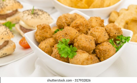 Party Food - Popcorn chicken, mini cheeseburgers, potato wedges, onion rings and breaded mushrooms with chili sauce and sour cream and chives dip.