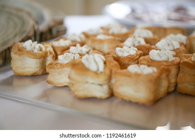 Party food: puff pastry vol-au-vents filled with mushroom ragout, topped with fresh parsley