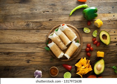 Party food. Tortilla wraps with vegetables. Mexican tortillas. Tacos with nachos and vegetables