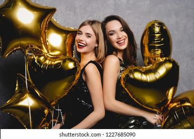 Party Fun. Beautiful Girls Celebrating New Year. Portrait Of Gorgeous Smiling Young Women Enjoying Party Celebration, Having Fun Together. High Quality Image