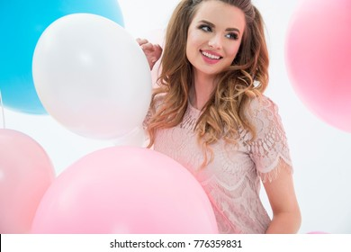 Party girl, balloons, having fun. Birthday party. Happy woman.