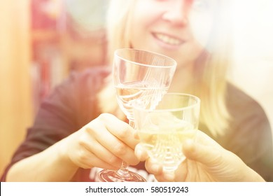 party girl drinking and toasting cheers with wine glass close up and defocused background