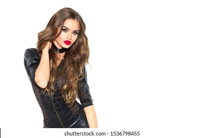 Party girl portrait. Halloween Witch with bright make-up and long hair. Smoky eyes. Beautiful young woman posing in sexy black leather dress. Isolated on white background