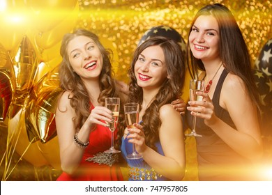 Party girls dancing in club. Women celebrate a holiday, a birthday or a new year.