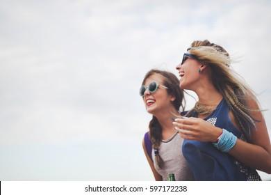 Party girls enjoying summer freedom and festival fun