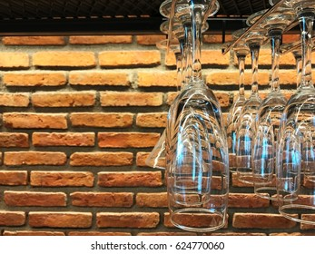 Party glass with empty space on brick wall