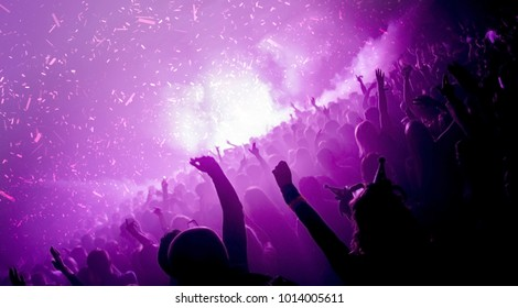 Party goers in a nightclub with co2 cannons firing
