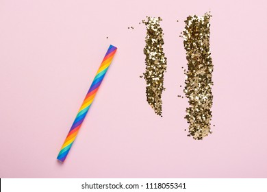 Party happiness addiction concept rainbow colorful straw and glitter on pastel background flatlay top view