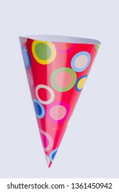 Party hat with pattern, vertical image. Red patterned Birthday cone cap. Isolated on white background.
