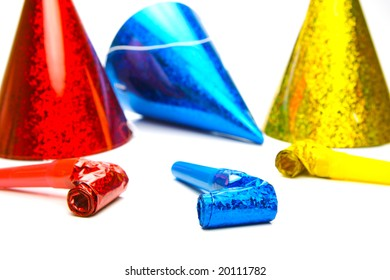 Party hats and blowers isolated against a white background