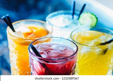 Party and holiday celebration concept. colorful cocktails and lemonades with ice in the restaurant bar table from the top view