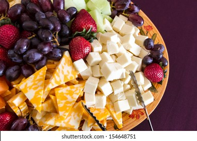 Party hors d'oeuvre platter of assorted cheeses and fruits from above