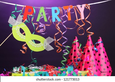 Party items on purple background
