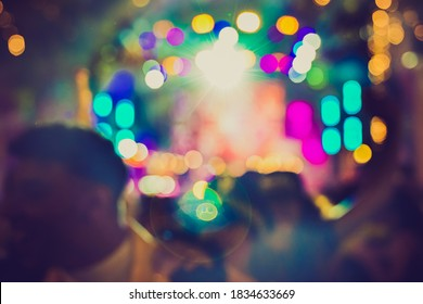 Party lights at night in the concert. Abstract colors circles background. Defocused picture.