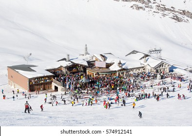 Party in mountain restaurant on the snowy slope at the ski resort