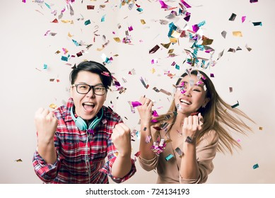Party People - Asian Friends Having Fun Dancing and Enjoying with Colorful Confetti in Christmas New Year or Birthday in Holiday - Happy Emotion