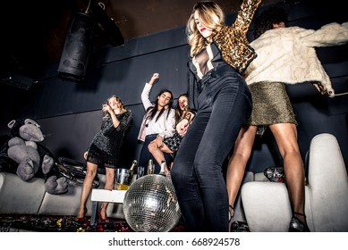 Party people celebrating in the club