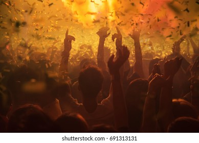 Party People concert in the club, Light Show ,Audience crowd people celebration festival ,The club DJ party people enjoy of music dancing sound, Golden grainy abstract  with crowd people Background.