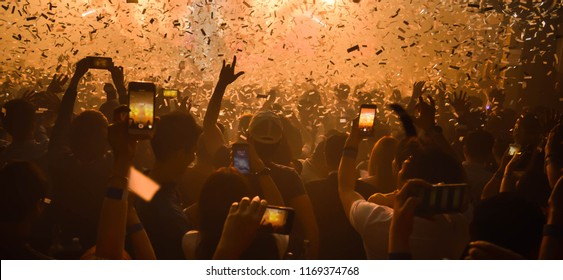 Party People light show concert. Crowd raising their hands and enjoying great festival party. Club Meeting Event  Birthday with Friend New Year Festival.