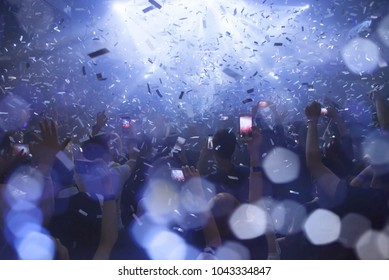 Party People light show effect blur bokeh  ,Crowd raising their hands and enjoying great festival party or concert. blur bokeh for background.