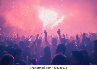 Party People Rock Concert. Crowd Happy and Joyful and Applauding or Clapping. Celebration party festival happiness. Blurry night club. Concert Show with DJ Music festival EDM on Stage City Party.