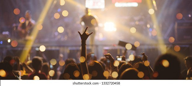 Party People Rock Concert. Entertainment Concert People Joyful and Applauding . Celebration party festival happiness. Social online event. Concert Show with DJ Music festival EDM on Stage City Party.