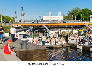 Party people/Popular summer open club on a pier in the Stockholm bay on the main quay. Stockholm, Sweden, May 19, 2018.