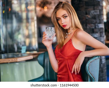 party photo of elegance lady in red dress with red lips