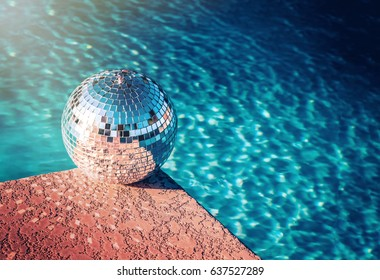 Party rave event disco ball beside swimming pool