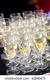 Party set of champagne flutes aligned and served in a tray