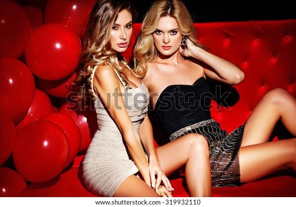 Party. Sexy girls on lounge. Celebrating.