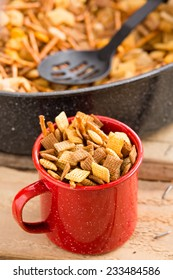 Party Snack Mix - This is a shot of a red mug filled with a holiday party mix. Shot with a shallow depth of field.