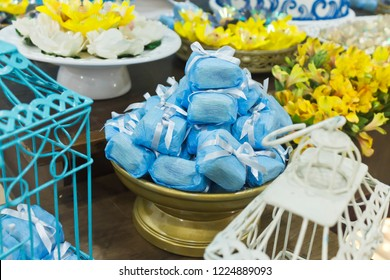 Party table decorated with tray of varied and well-married candy in close up