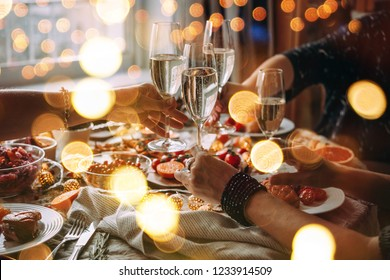 Party table with glasses of champagne. Friends celebrating Christmas or New Year eve.