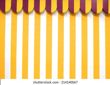 Party tent background pattern, with yellow and white stripes. Photo was taken in August 2014.