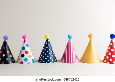 Party theme with with hats on an off white background