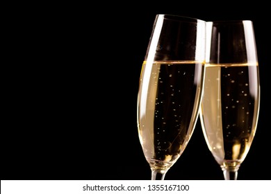 Party time. Champagne glasses on black background. Holiday celebration concept.