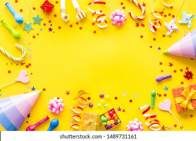 party time frame with decorations on yellow background top view mock up