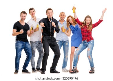 It's party time! Group of happy smiling friends with bottles of beer having fun together. Isolated on white.