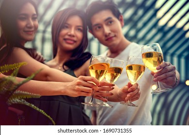 Party time start. Happy people toasting with champagne flutes. Multiethnic friends congratulating each other with new year. Celebration holiday concept, holiday background. selective focus.
