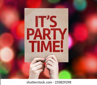 It's Party Time written on colorful background with defocused lights